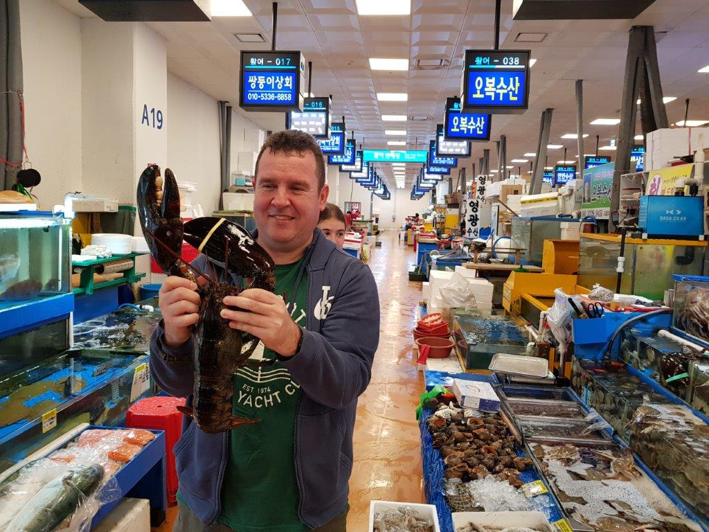 Tony getting up close and personal with a lobster at Noryangjin Fish Market in Seoul, South Korea