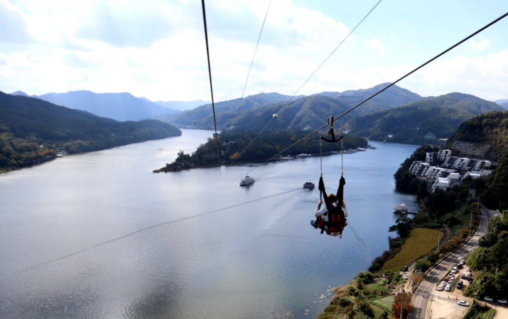 View of our youngest son on the Nami Island Zipline - you can see Nami Island in the middle of the river